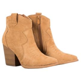 Bella Paris Cowboy støvler på en post brun