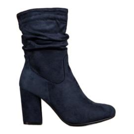 Kayla Høje støvler på en stolpe blå