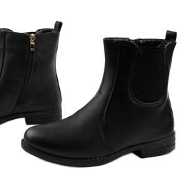 Sorte flade ankelstøvler med elastik og Trini-lynlås 1